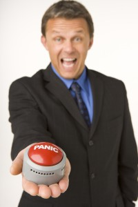 2169207-businessman-holding-a-panic-button